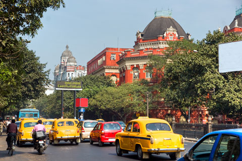 A busy road with yellow taxis
